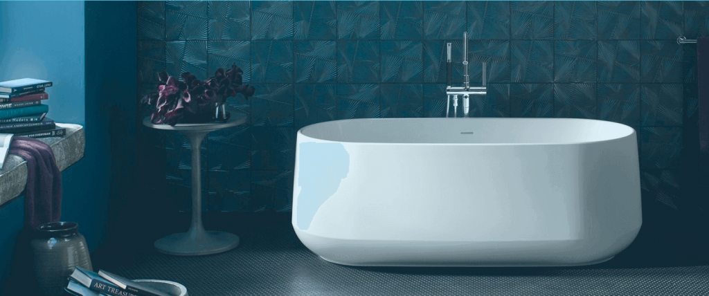 A beautiful bathroom with blue tile and a modern white bathtub. Creating beautiful bathrooms on a budget is something Home Forever Baths has helped many Northern Illinois homeowners with.