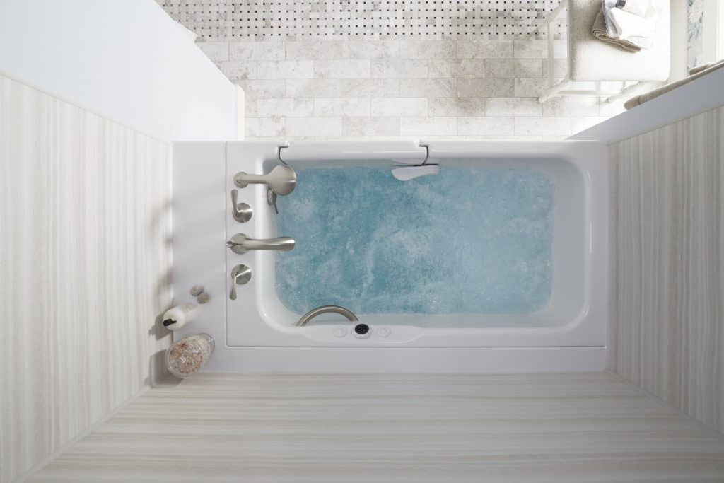 A top view of an inviting, warm Kohler walk-in tub.