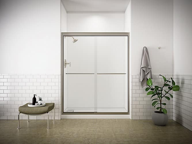 A bathroom with a beautiful Kohler shower in brilliant white. Choosing the right shower for your bath is essential to a successful remodel and a bathroom you'll enjoy for years to come.