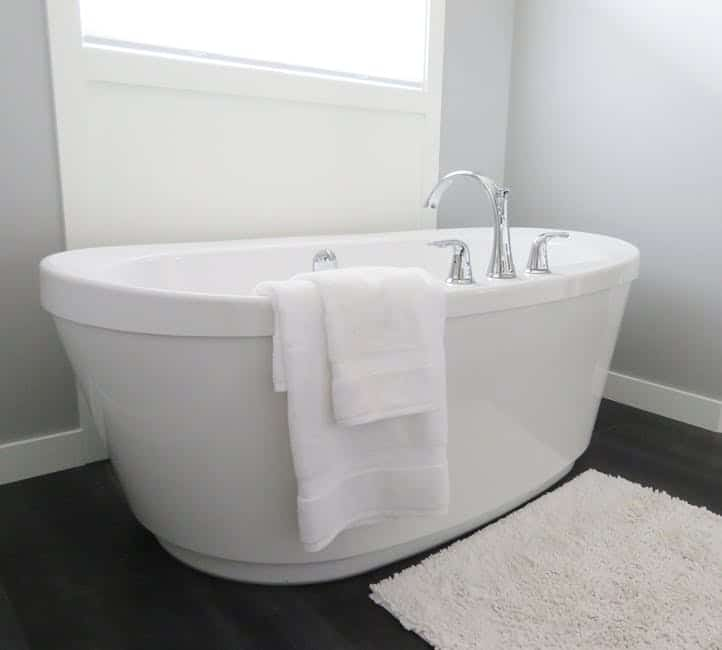 A modern white bathtub. Bathtub replacement is a simple and effective option to improve your bathroom.
